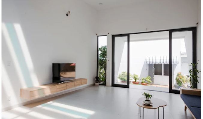 Nhà lệch tầng lấy sáng với thiết kế độc đáo. 2